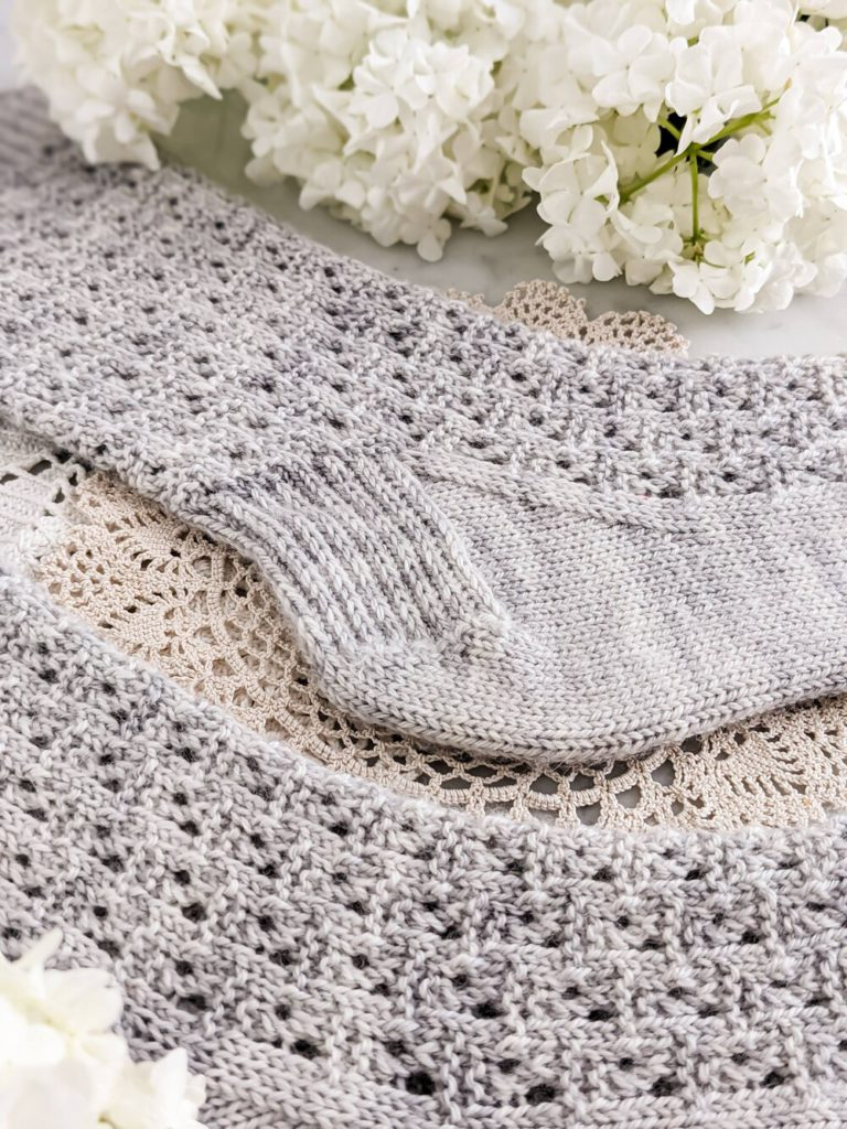 A close-up on the heel flap and gusset of this free sock knitting pattern.