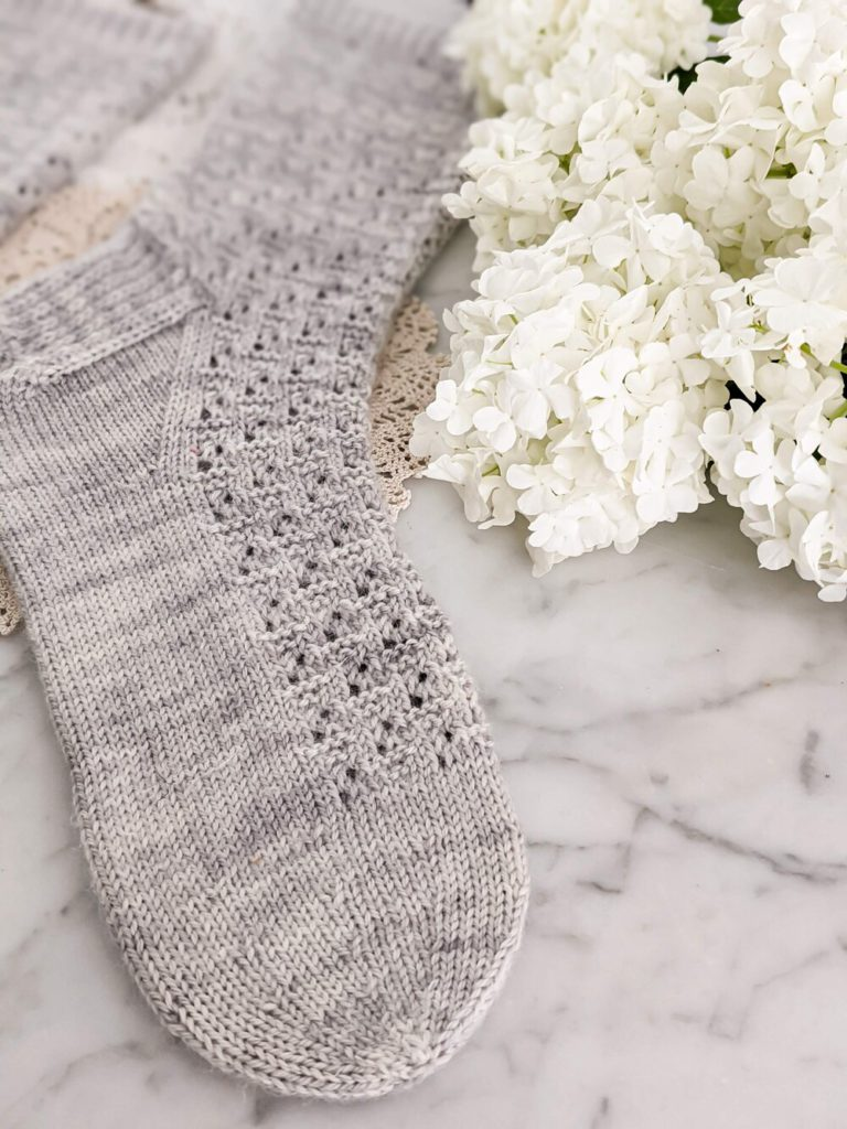 A close-up on the round toe of this free sock knitting pattern.